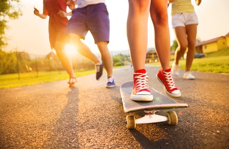 31523695 - closeup of legs and sneakers of young people on skateboard