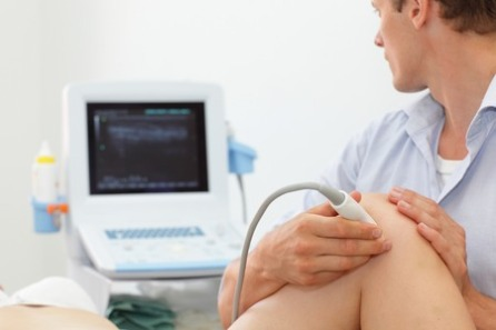 45100241 - female patient's knee joint dynamic test carried out with the use of an ultrasound